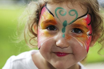 Toddler girl with butterfly face paint
