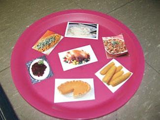 Plate of cut out food for feast relay race
