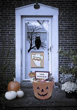 Front door with Halloween decorations and boo sign