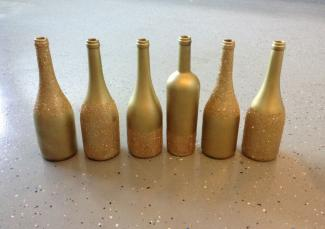Gold glitter wine bottles