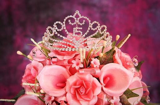 Quinceanera Crown on top of pink flowers