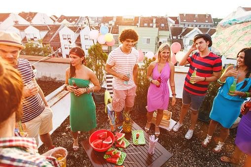 people on rooftop party