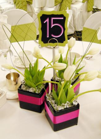 pink and black centerpiece with flowers