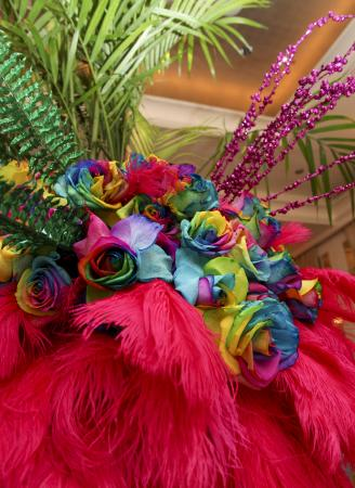 Rainbow rose arrangement with pink feathers