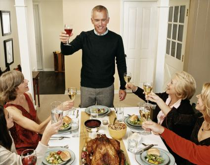Man Leading a Toast at a Thanksgiving Meal