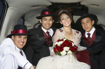 Girl and boys in limousine at Quinceanera