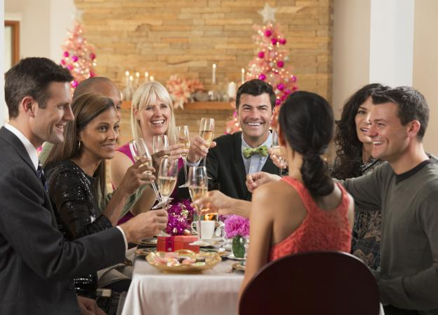 Coworkers toasting at holiday dinner party
