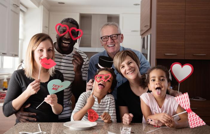 Multi-Ethnic family doing photobooth during Valentine's day