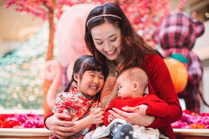 Mom hugging her daughter and her baby during Chinese New Year
