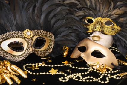 golden mardi gras masks with feathers