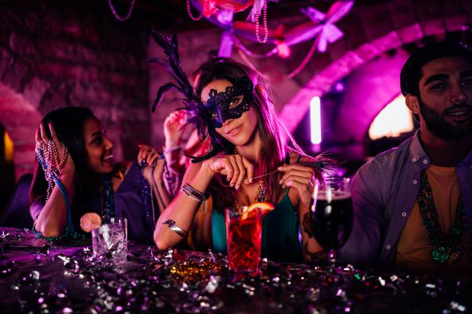 woman with mask at Mardi Gras night club party