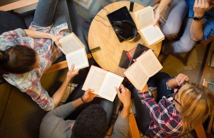 friends discussing a book