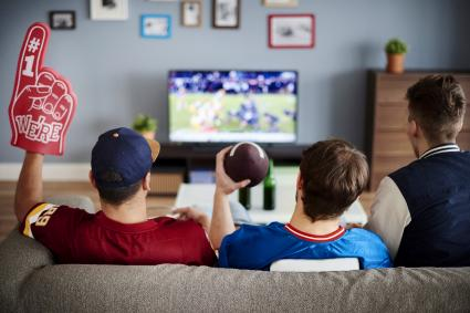 Three men watching Football