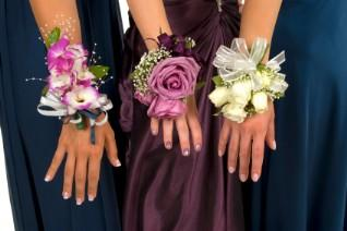 Three girls wearing wrist corsages