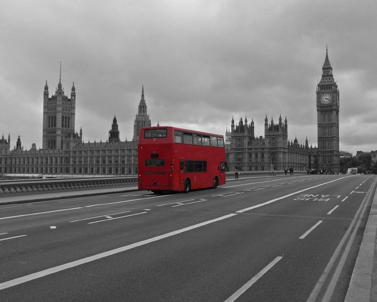 London street with red streetcar