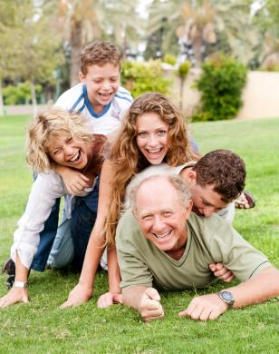 outdoor portrait with grandfather and grandkids