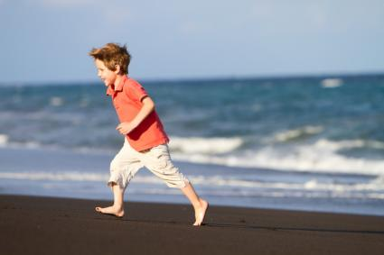 boy running on beach
