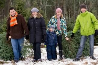 family christmas portrait with tree
