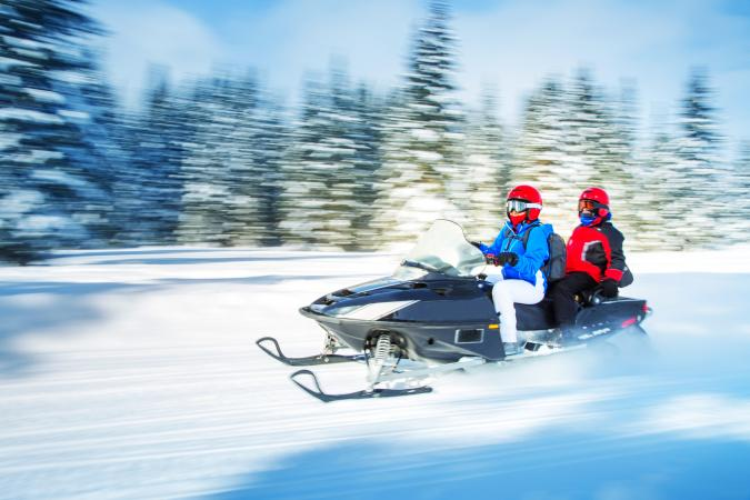 Blurry snowmobiling photo