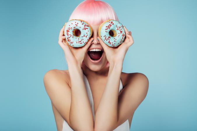 Pretty blonde with multi-colored donuts