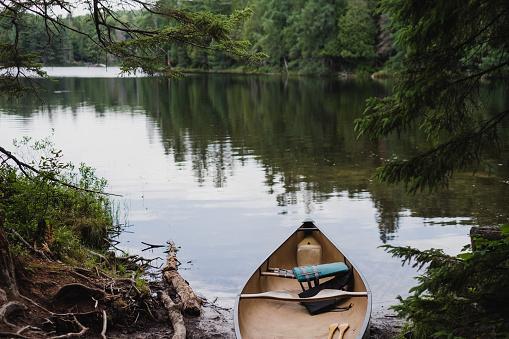 Canoe sitting lakeside