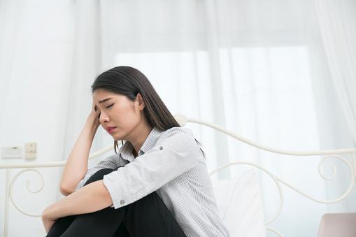 Sad woman in a room