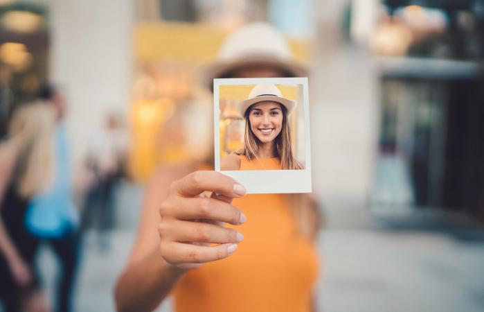 Woman showing polaroid