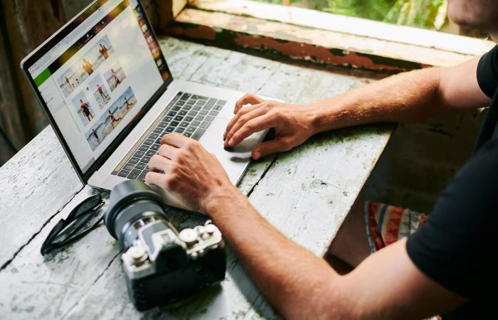 Photographer on laptop