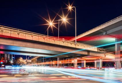 Star Filter Light trails under a viaduct at night