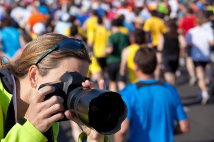 photographer taking pictures at marathon