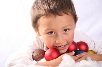 Boy with Christmas ornaments