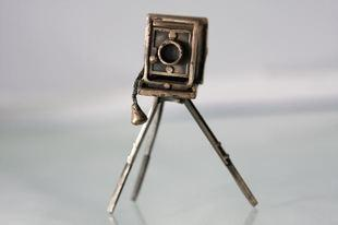 Antique cameras on tripods are great to display.