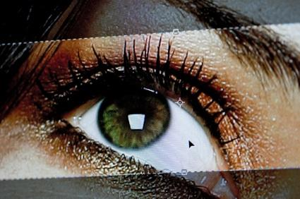 Retouching a digital photo of a human eye.