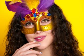 Woman in queenly mask