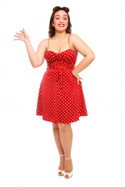 Woman in red polka dot dress