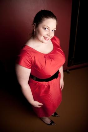 curvy model in a red holiday dress