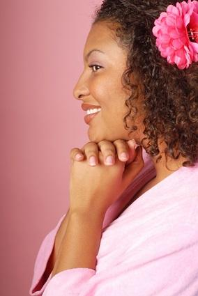 Woman in pink spa attire