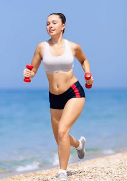 Full figured woman running on beach