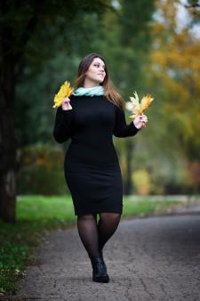 Plus size black dress with black pantyhose