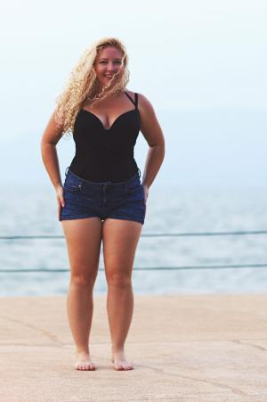 Woman in denim shorts at beach