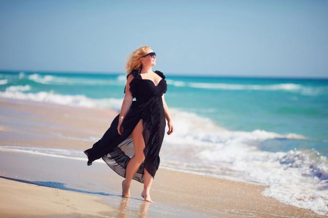 woman on beach in black dress