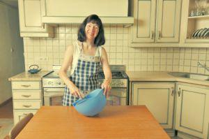 Woman cooking in retro kitchen