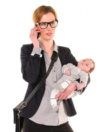 Business woman holding baby