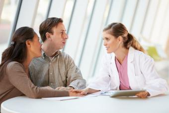 Couple talking to their fertility specialist