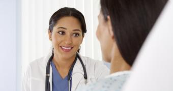 Doctor delivering good news to patient; © Rocketclips, Inc. | Dreamstime.com