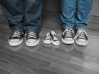 Dad, mom and baby shoes