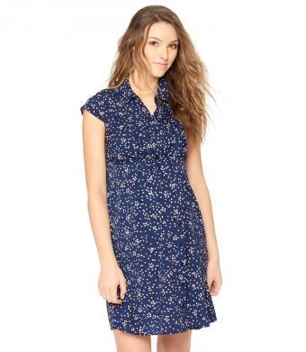 Woman in a navy print maternity shirt dress
