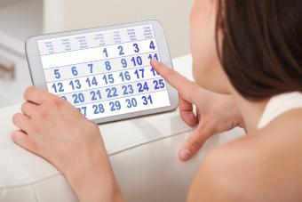 Woman Using Calendar On Tablet