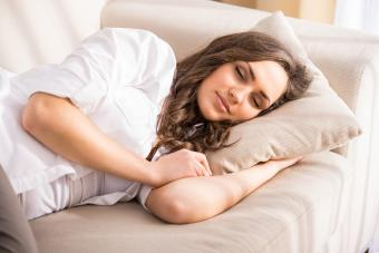 fatigued woman sleeping on couch