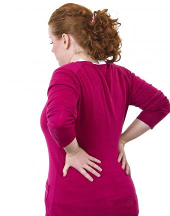 Young woman with lower back pain